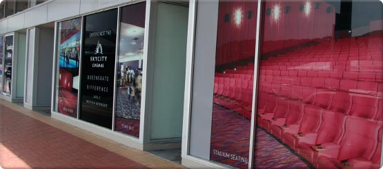 High impact signage applied to glass windows